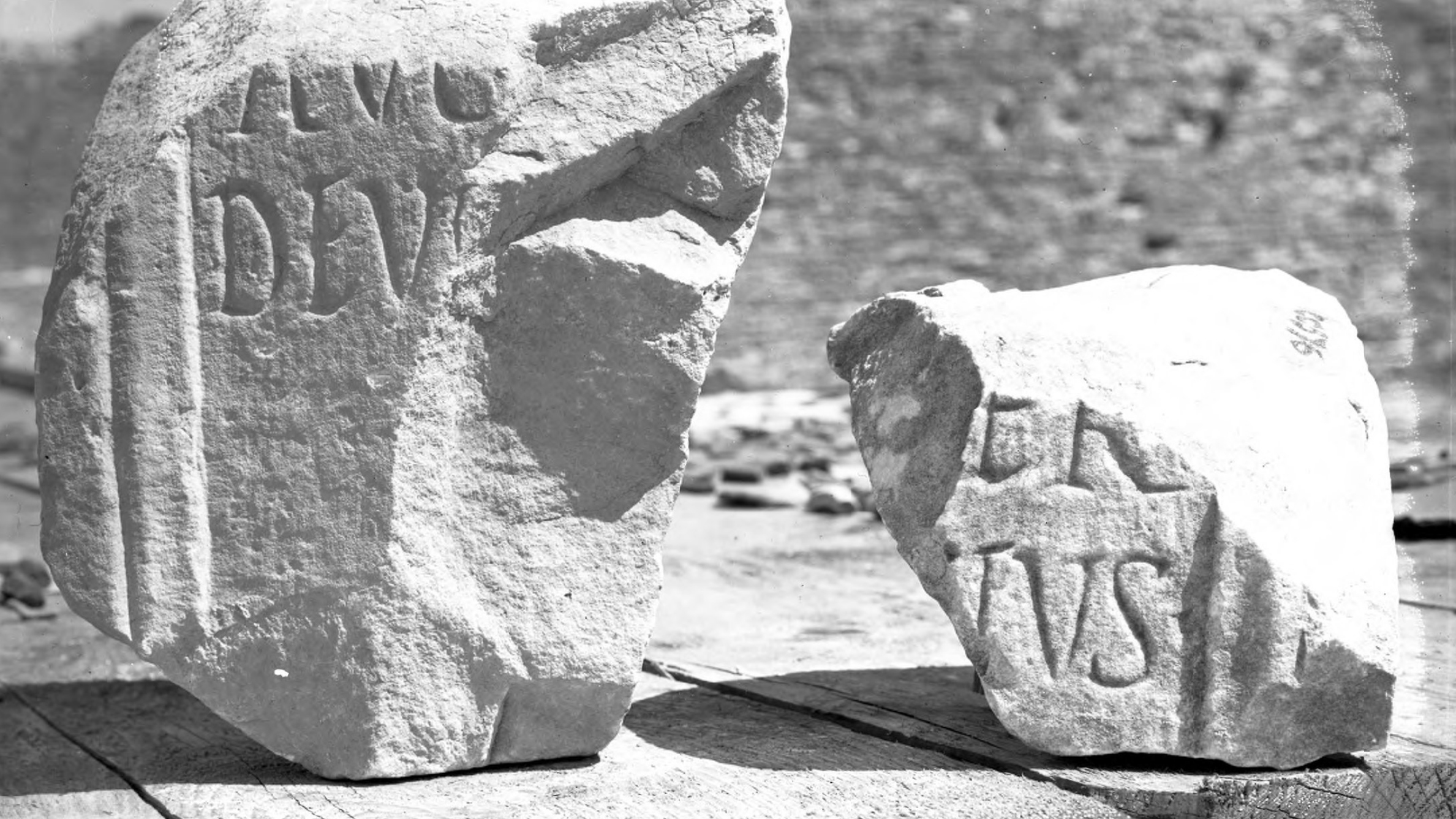 Black and white photograph of two stone fragments with inscriptions